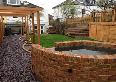 Reclaimed Victorian brick pond and pergola. Family garden brighton