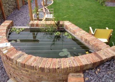 Reclaimed Victorian brick pond. Family garden brighton