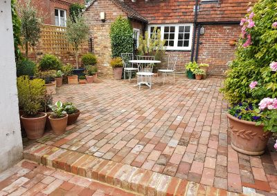 Patio laid with reclaimed bricks to complement the house