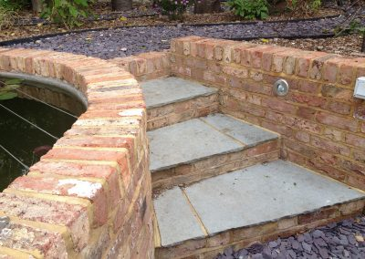 Reclaimed brick pond and slate steps, family garden brighton
