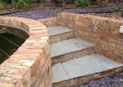 Reclaimed brick pond and slate steps, family garden brighton