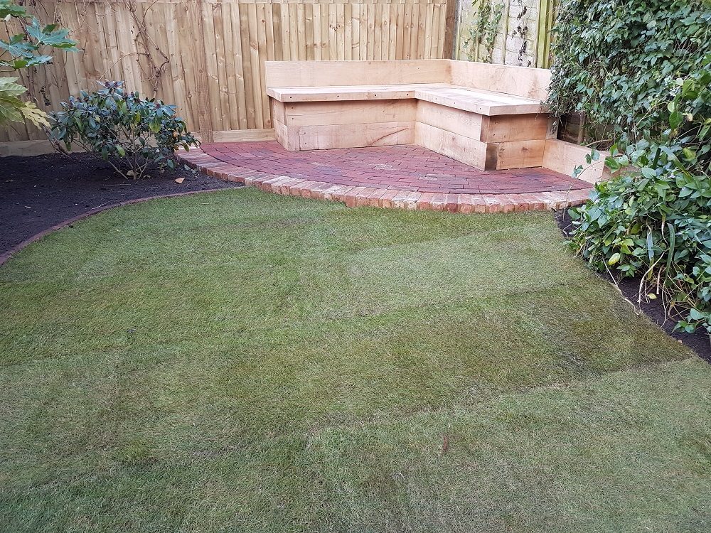 Reclaimed brick patio and storage bench to lawn
