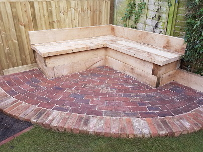 Reclaimed brick patio and storage bench