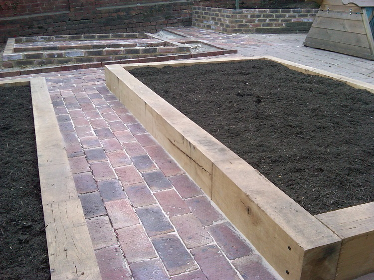 Reclaimed Victorian bricks and oak raised beds
