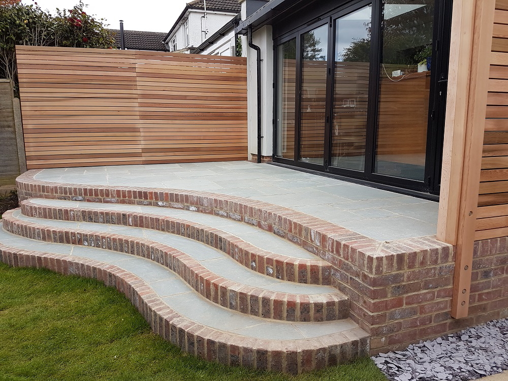 Landscape Design Brighton - Natural stone and reclaimed brick curved steps