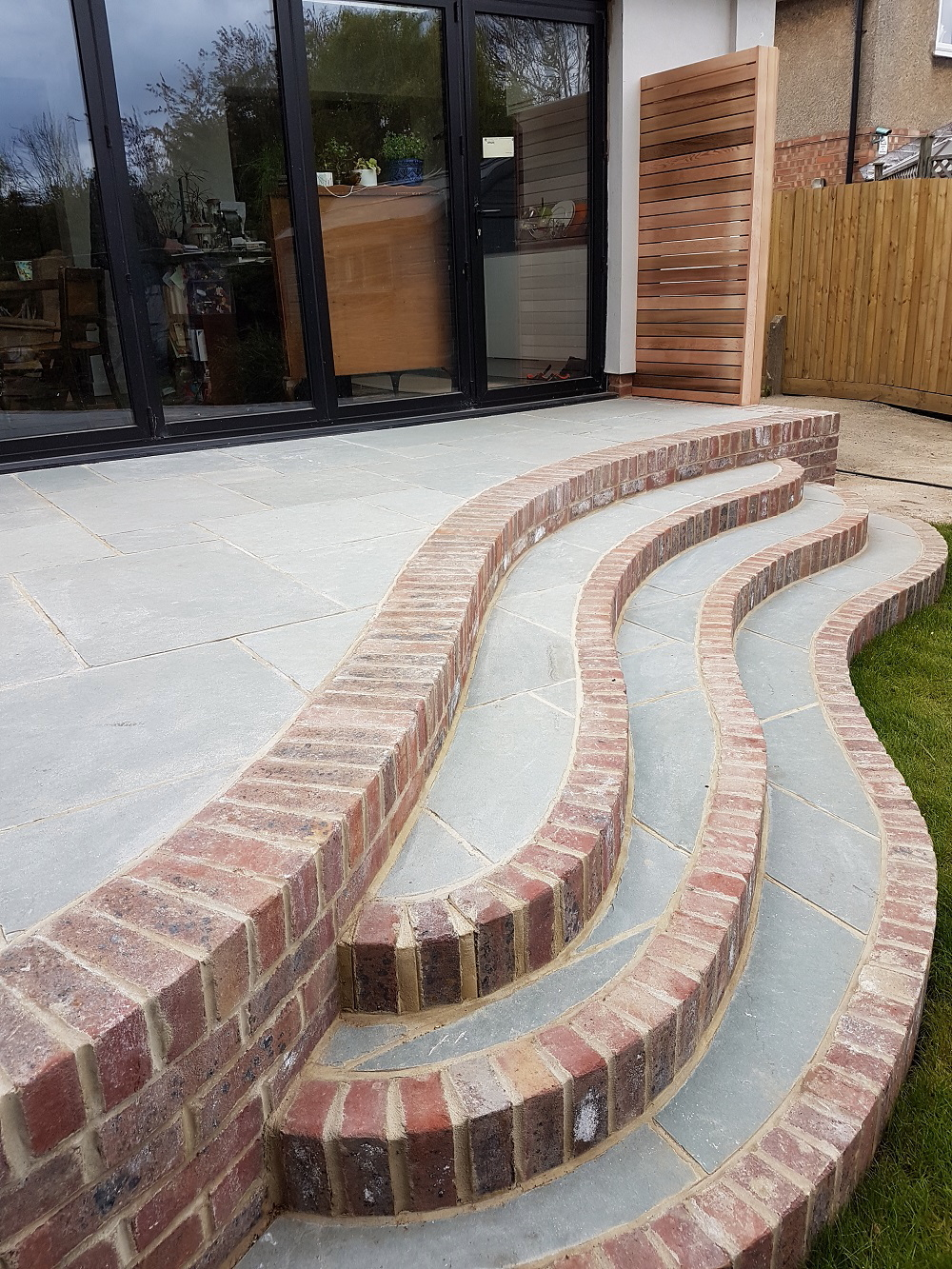 Natural stone and reclaimed brick curved steps