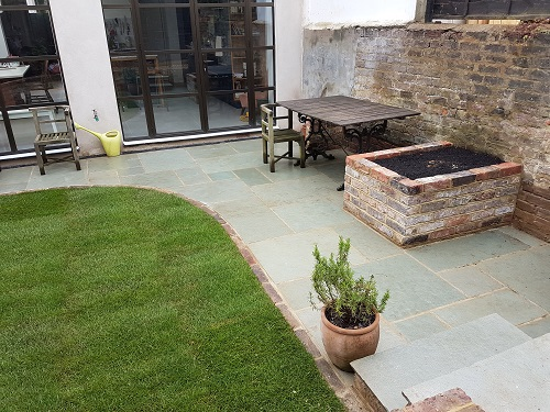 Landscape Design Brighton - Levelled and turfed lawn, blue limestone patio and raised brick planters