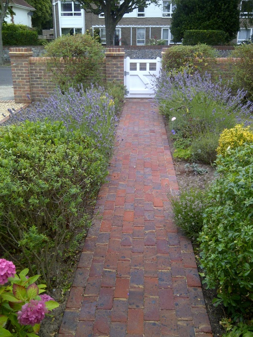 Mixed stock brick garden path and shrub planting